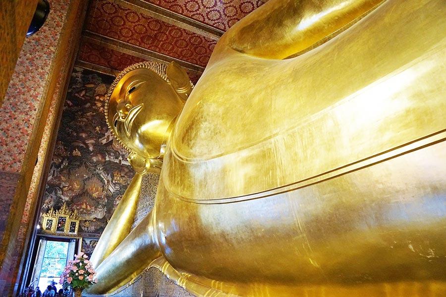Visit the Reclining Buddha at Wat Pho Temple, Bangkok