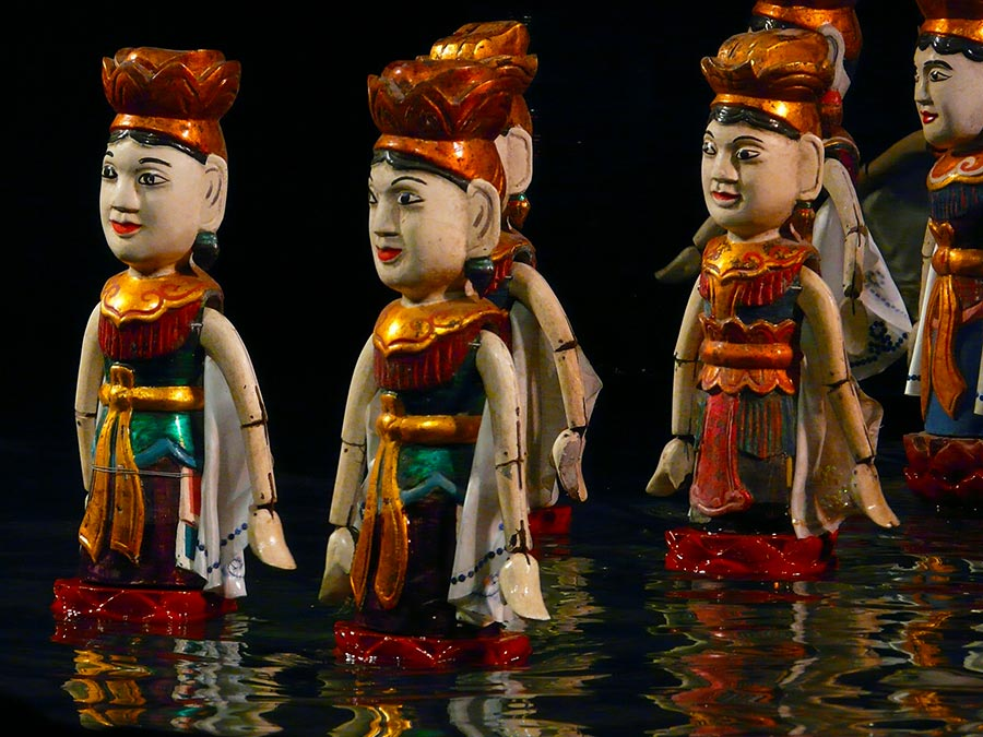 Go to a water puppet show in Hanoi